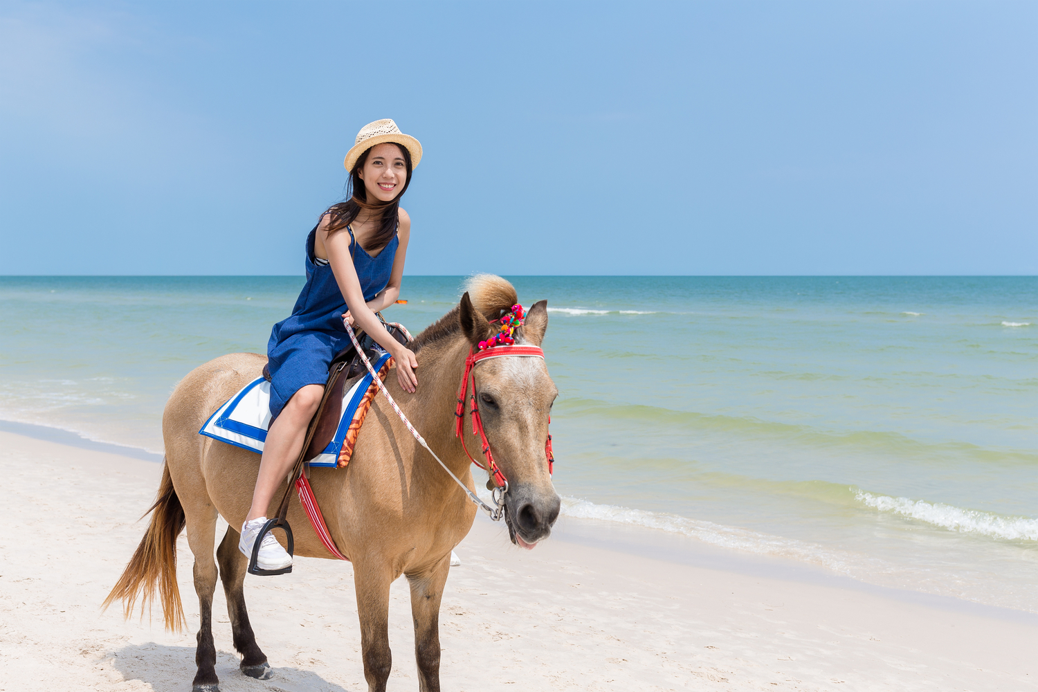 Picture of a girl going horseback riding in the Bahamas.