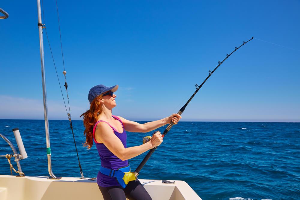 A woman fishing in Nassau, Bahamas.